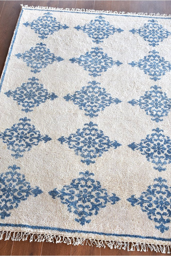 abano wool rug in ivory and blue color