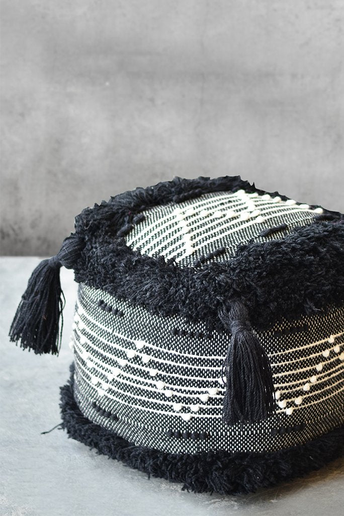 levanzo wool pouf in ivory and charcoal color