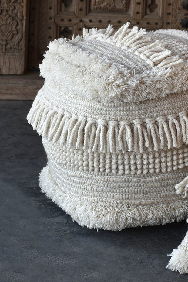 bartow wool pouf in ivory color