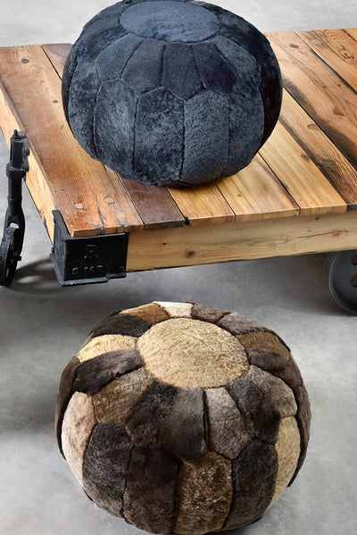 beacon hide pouf in charcoal color