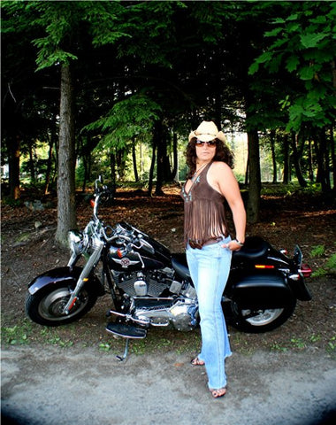 lisa with her harley wearing one of  her original suede halter top designs