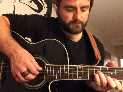 "Musician Alex Young wearing his Kama Braided Leather Ring while playing ""Bella"" his black beauty guitar"