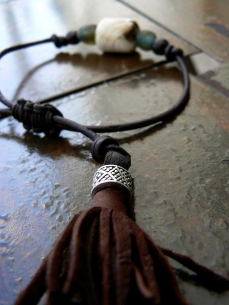 Naja Vintage Conch Shell & Glass Beaded Adjustable Leather Bracelet close up leather tassels