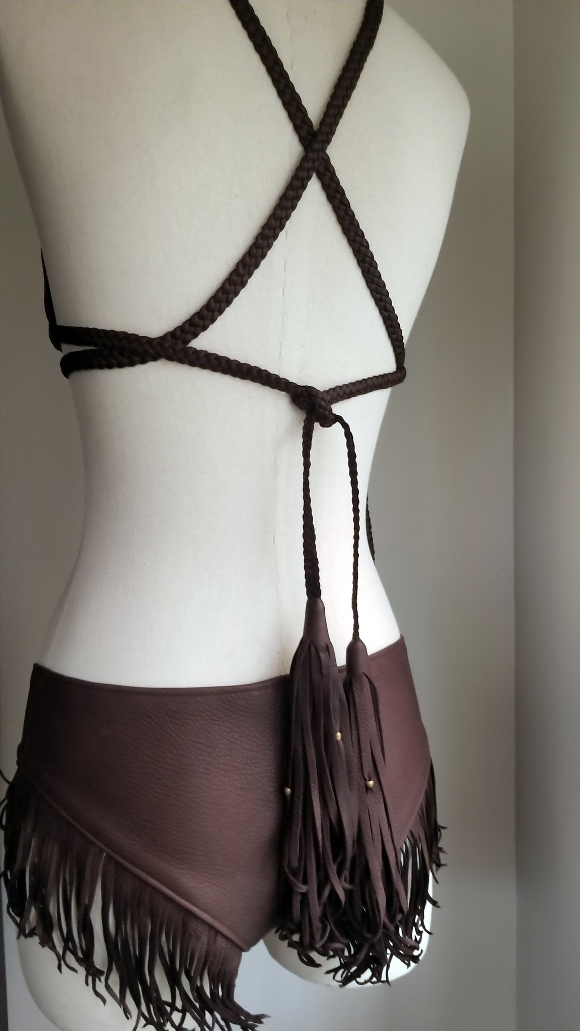 leather bikini set, deerskin leather boy booty shorts bottoms, triangle leather top with braided leather ties and straps, tassels and african beads, chocolate brown on mannequin