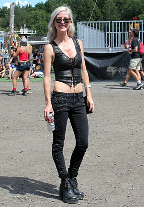 A customer, Emily, wearing a black deerskin leather Rebel Halter Top