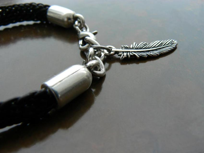 Yuki Braided Round Leather Cord Beaded Bracelet close up of silver lobster clasp and silver feather charm