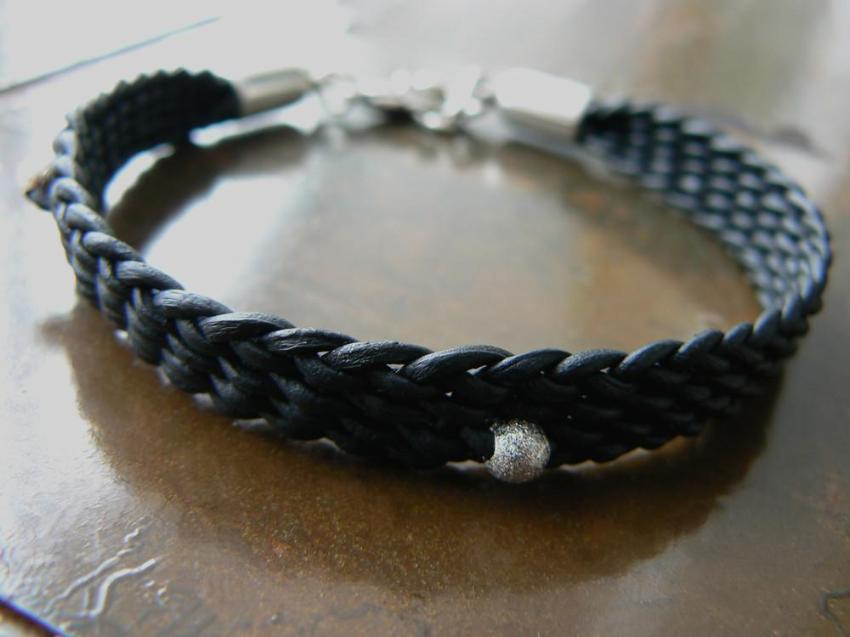 BLACK YUKI BRAIDED LEATHER BRACELET with silver lobster clasp and silver feather charm