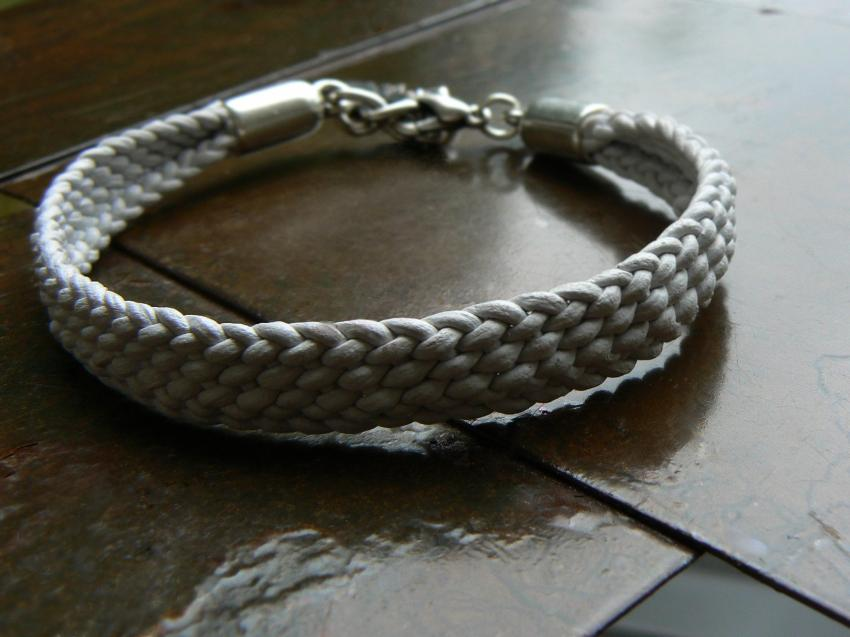 White Yuki hand braided leather bracelet with silver feather charm, lobster clasp and NO silver beads
