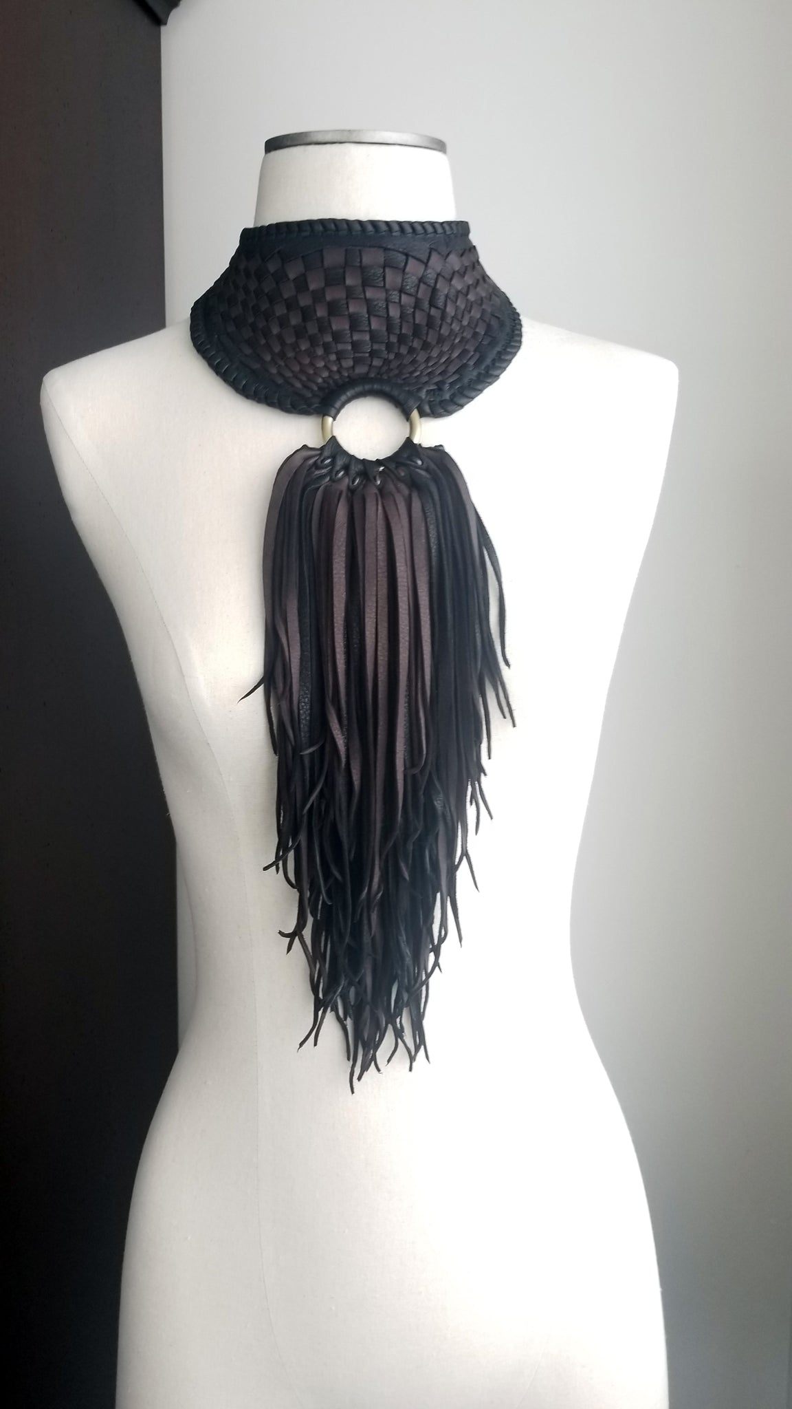 Zanta African Inspired, Braided Leather Statement Necklace, Bib Neckpiece, woven collar, fringe and tassels, on a dress form form
