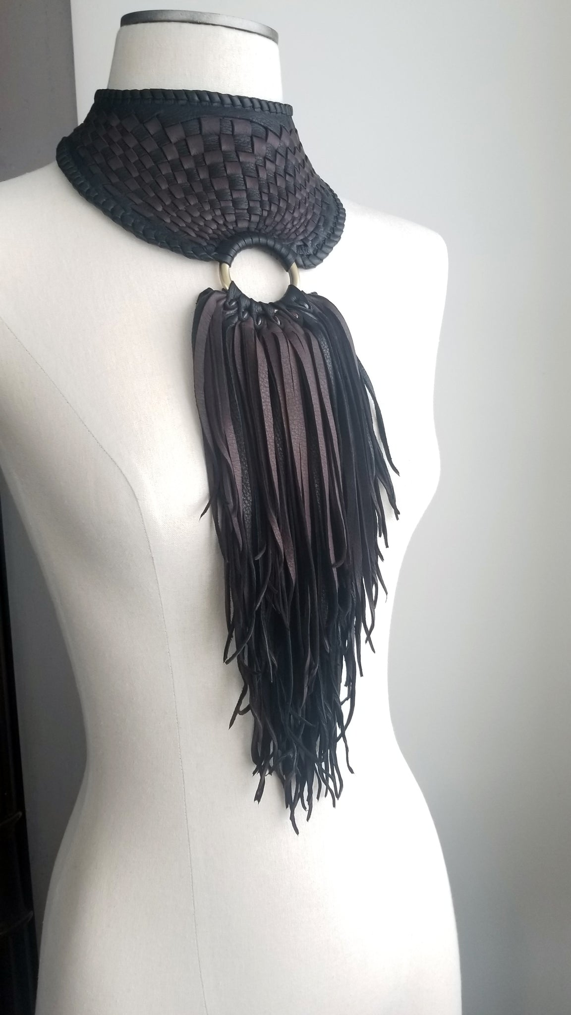 Zanta African Inspired, Braided Leather Statement Necklace, Bib Neckpiece, woven collar, fringe and tassels, on a dress form
