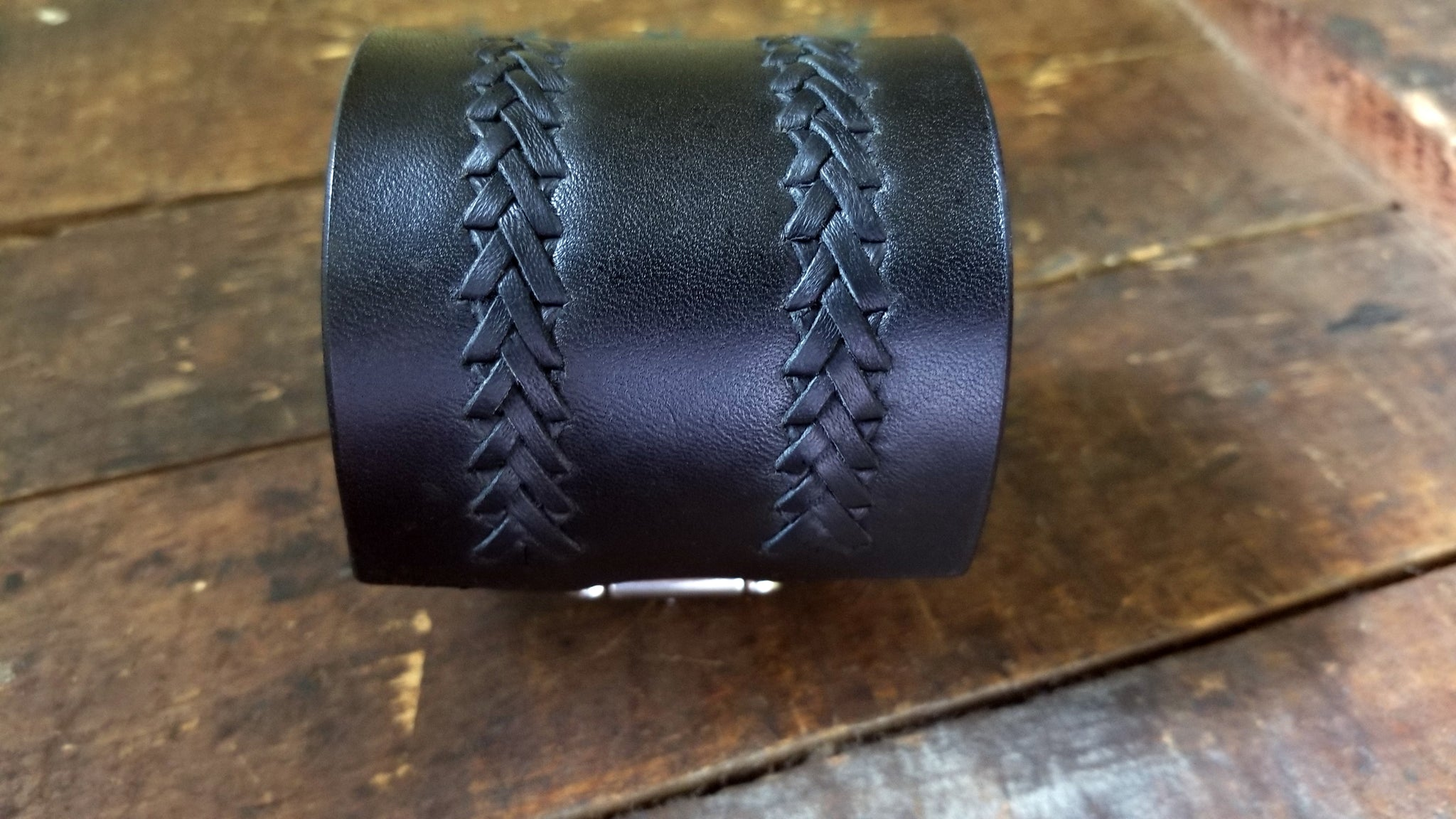 front view of the hand lacing on Aga Braided Leather Buckle Cuff, black