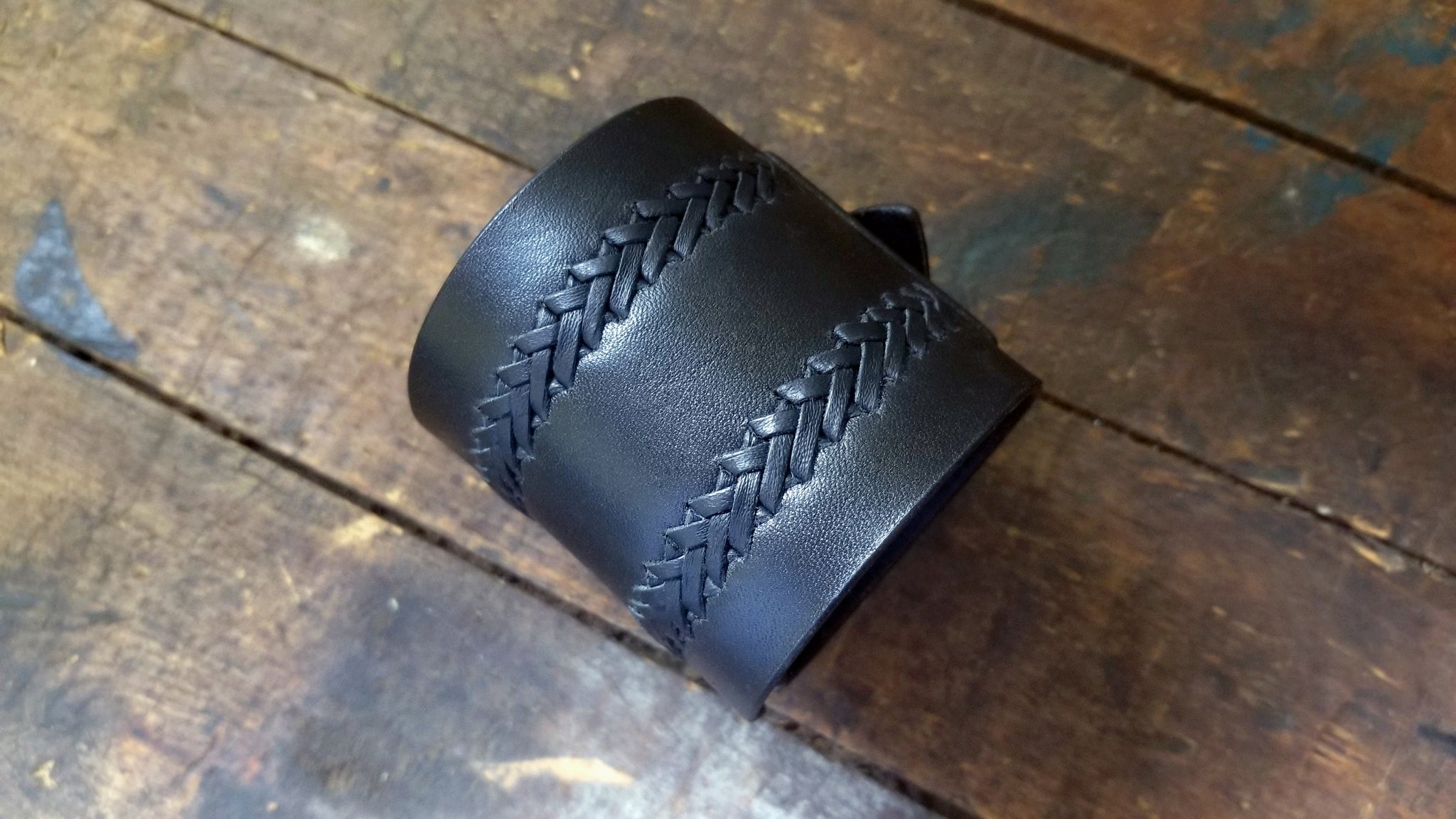 Aga Leather Cuff, wide wrist band with hand braiding detail