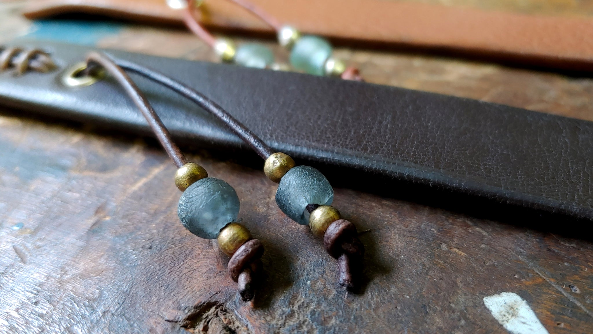 Cliff Booth (Brad Pitt) inspired bracelet in the color Tobacco with seagreen and silver African Beads and chocolate Brow w/ Denim Blue and Brass African Beads