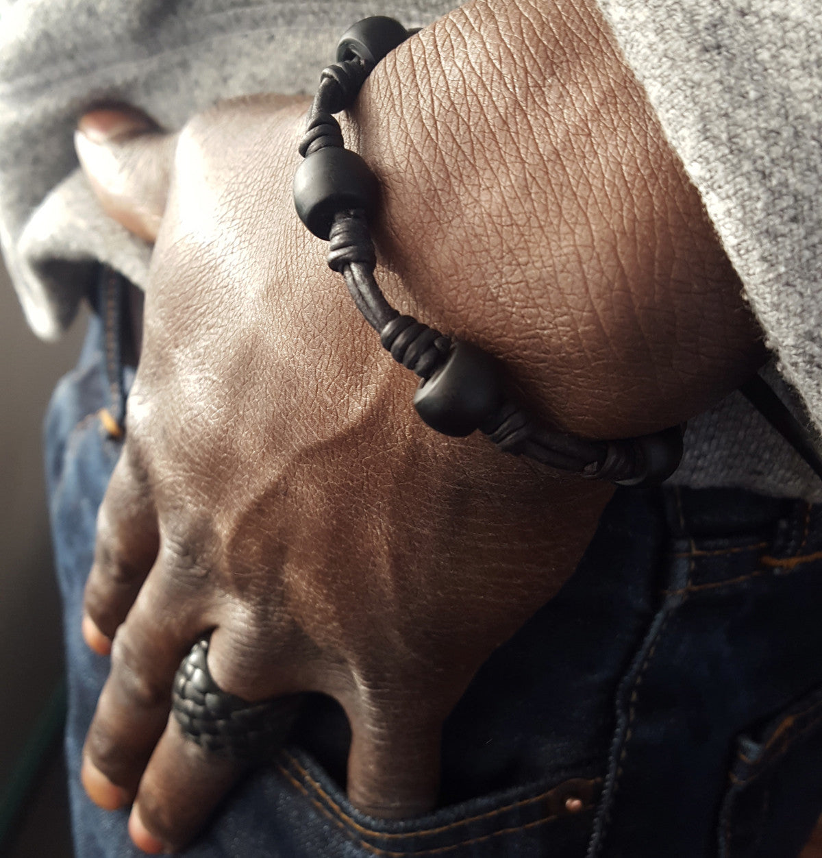 old black African Trade Padre Posser Beads Black Leather Adjustable Stackable Bracelet on male model