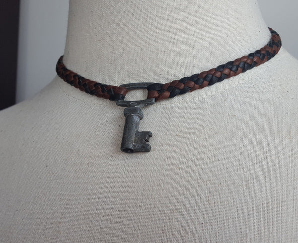 unique and limited stock of vintage french key on a braided leather corded necklace on a male mannequin form
