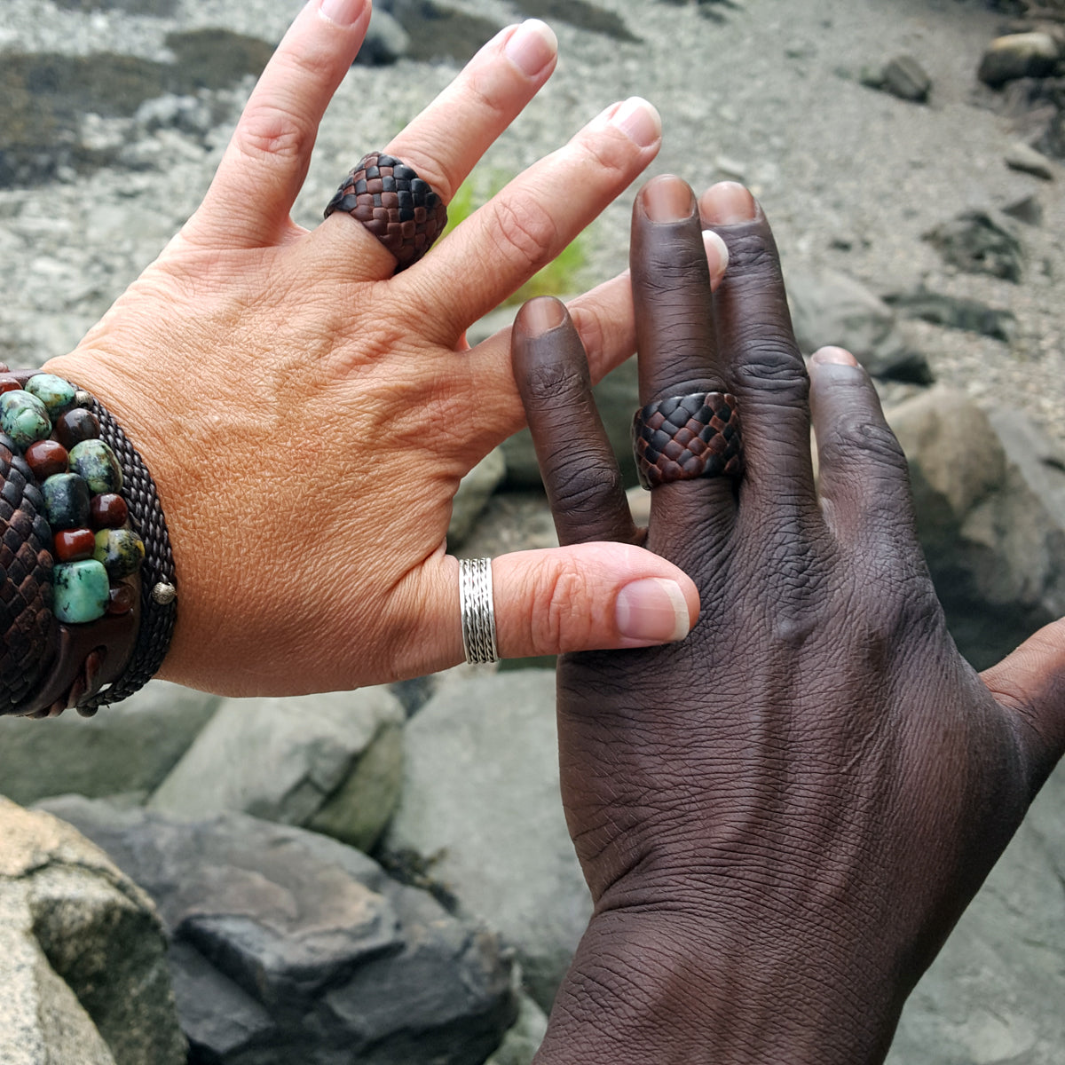 "chocolate and mahogany kama braided leather rings, 3/4"" and 5/8"" on male and female models"