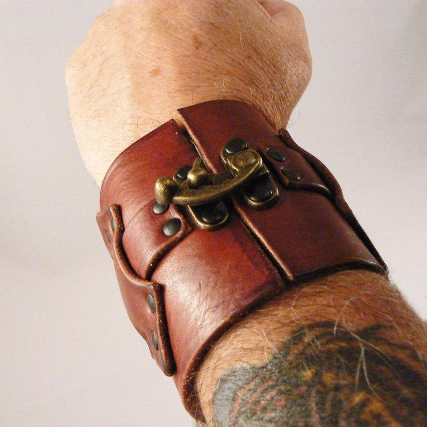 Hook Wide Leather Cuff on male model, with Hook & Latch, Tobacco Aztec Leather and Antique Brass Hardware