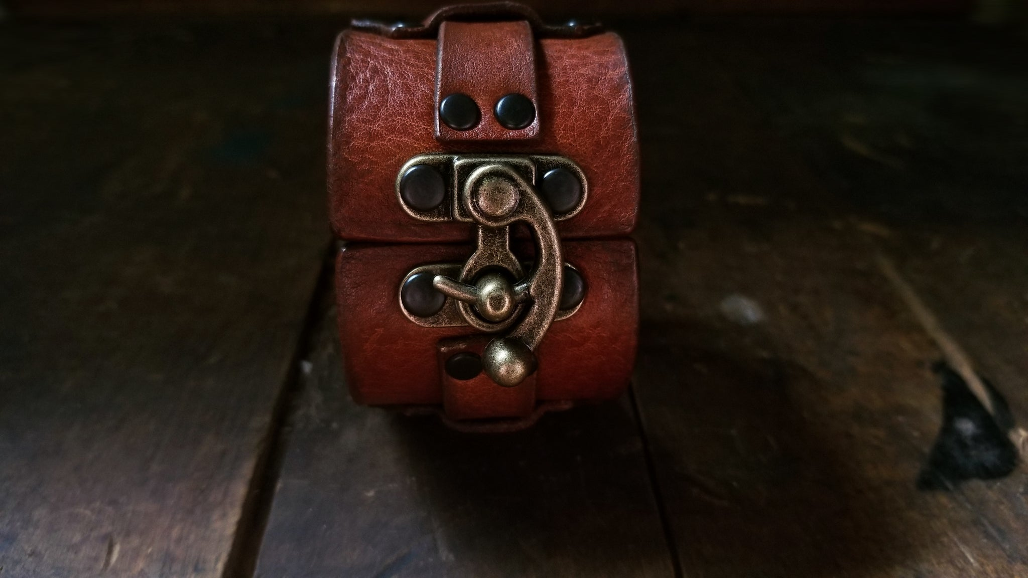 Hook Leather Cuff - Slim. Wide leather snap cuff with antique brass hook & latch in the color tobacco