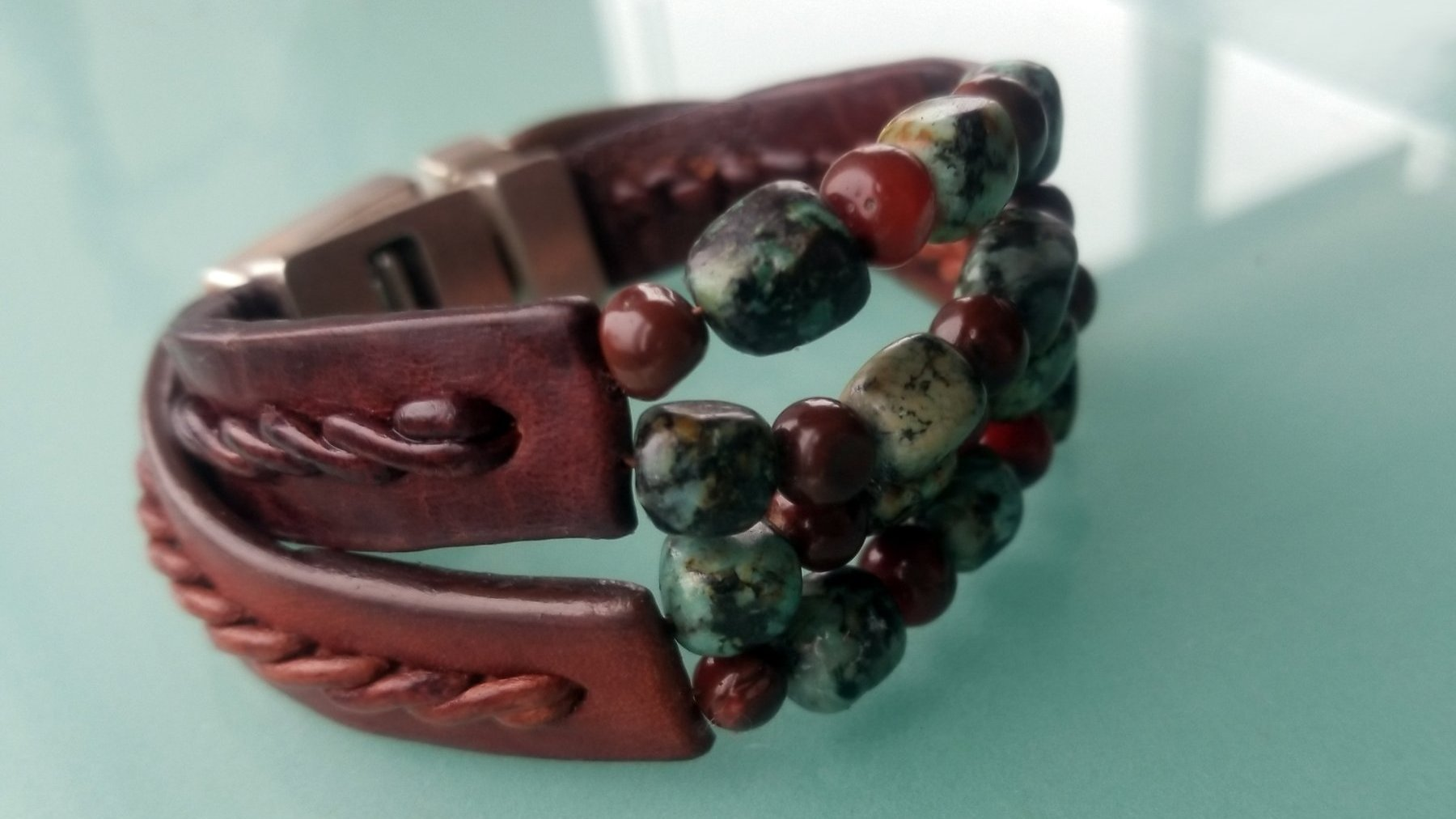 Kuende Leather Bracelet | African Turquoise & Red Carnelian Stone Braided Bracelet in Tobacco Aztec Leather (bottom) and Cognac Aztec Leather (top)