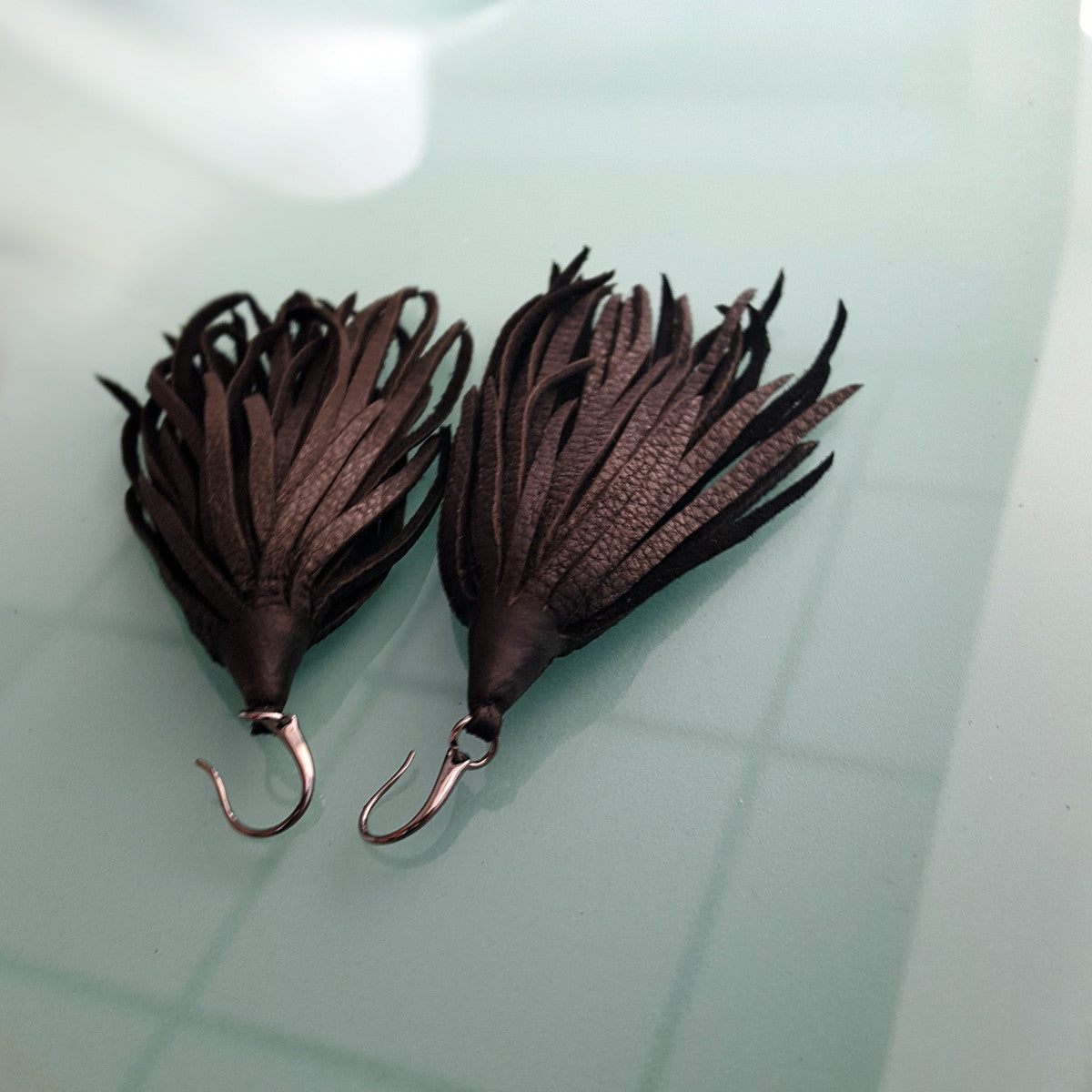 Mini-Mini Kimani Tassel Earrings in black deerskin leather with gunmetal earring hooks