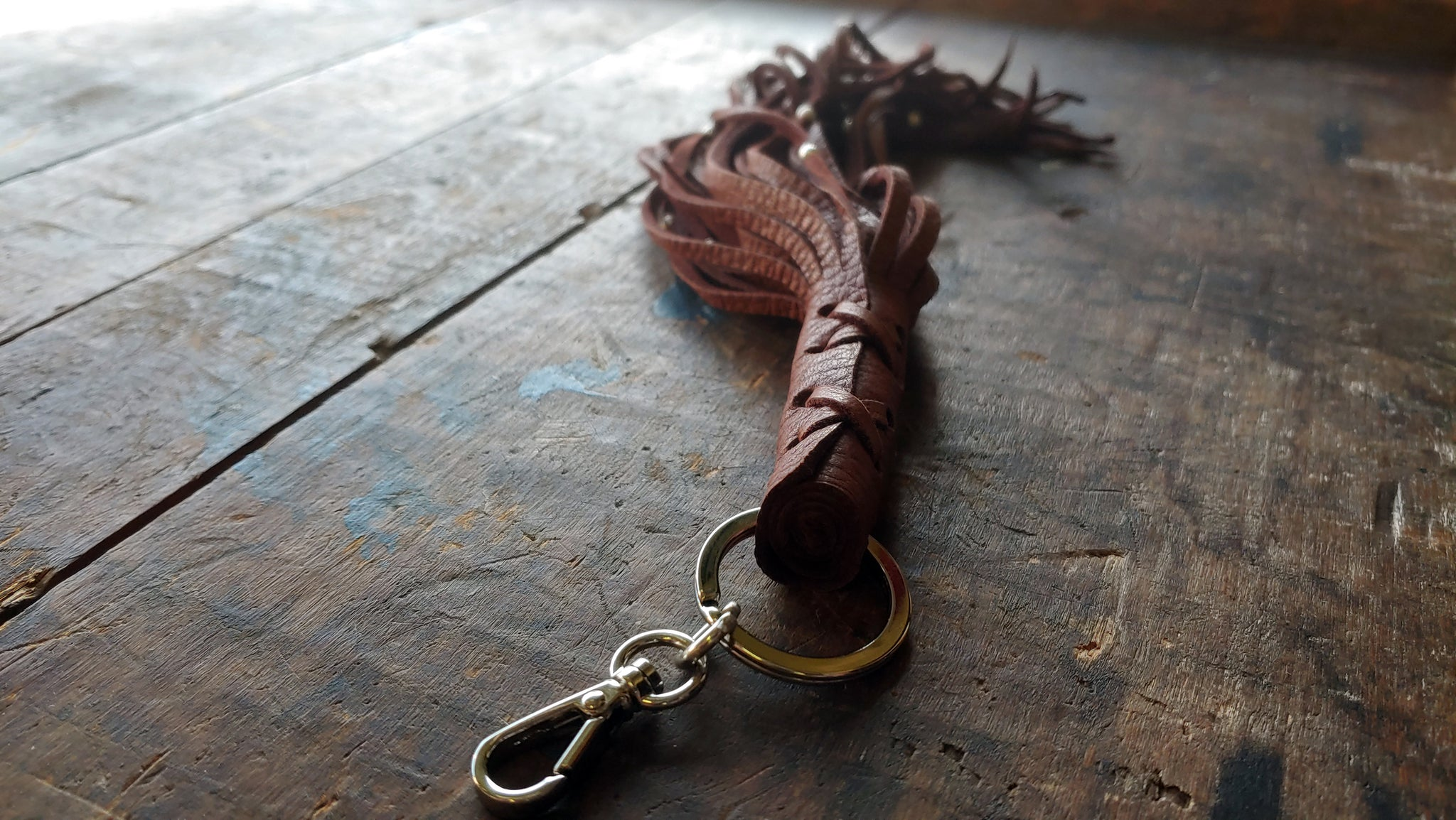 Nala Leather Tassel Key Chain in mahogany deerskin with silver beads and clip