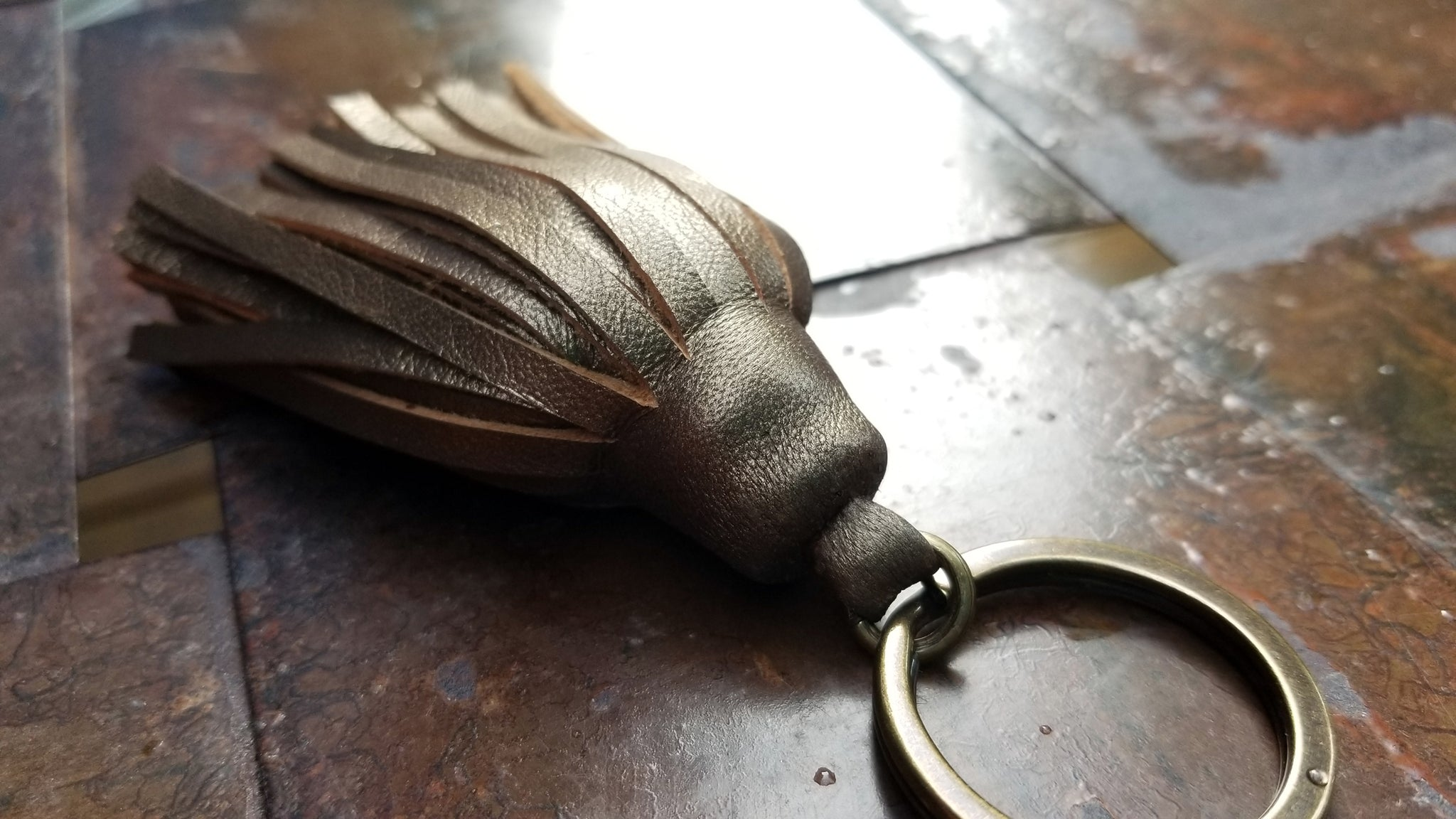 Lulu leather tassel key chain purse pocketbook charm, color; pearlized bronze