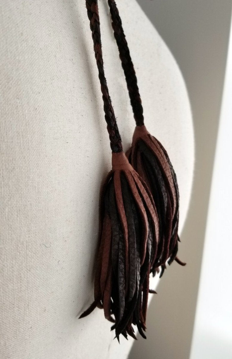 chocolate and black leather tassels on the slave necklace