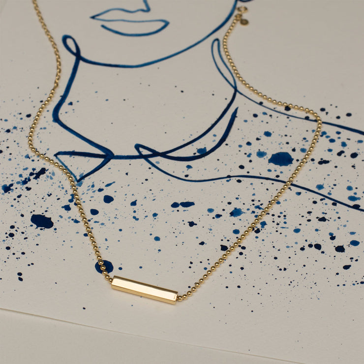 charlie gold ball necklace | illustrated human