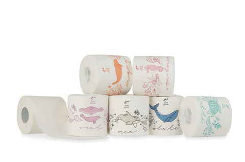 Assortment of stacked Pure Planet Club bamboo toilet paper rolls