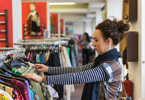 Woman Browsing Through Store Clothing