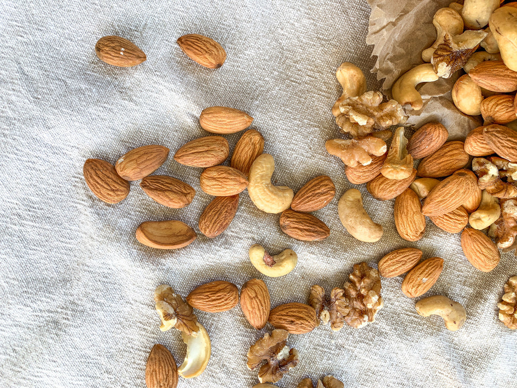 Naked Paleo Blog Recipe Why We Love and Use Nuts as an ingredient in our whole food bars healthy fat fats