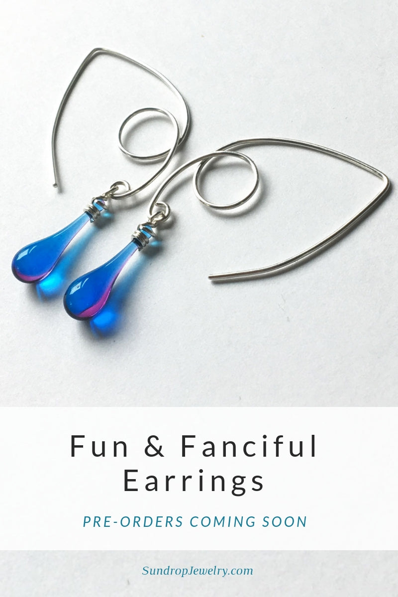 Fun and fanciful silver marquise earrings with sun-melted glass drop dangles