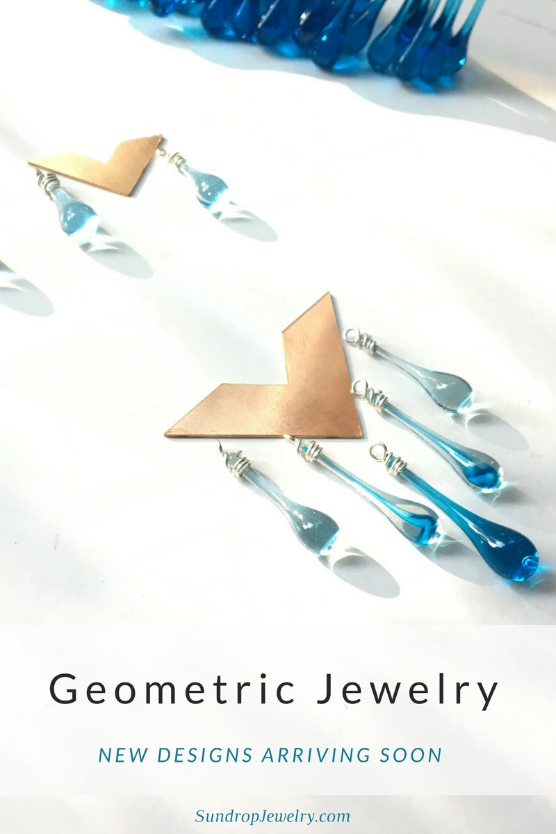 Geometric statement jewelry in bronze by Sundrop Jewelry