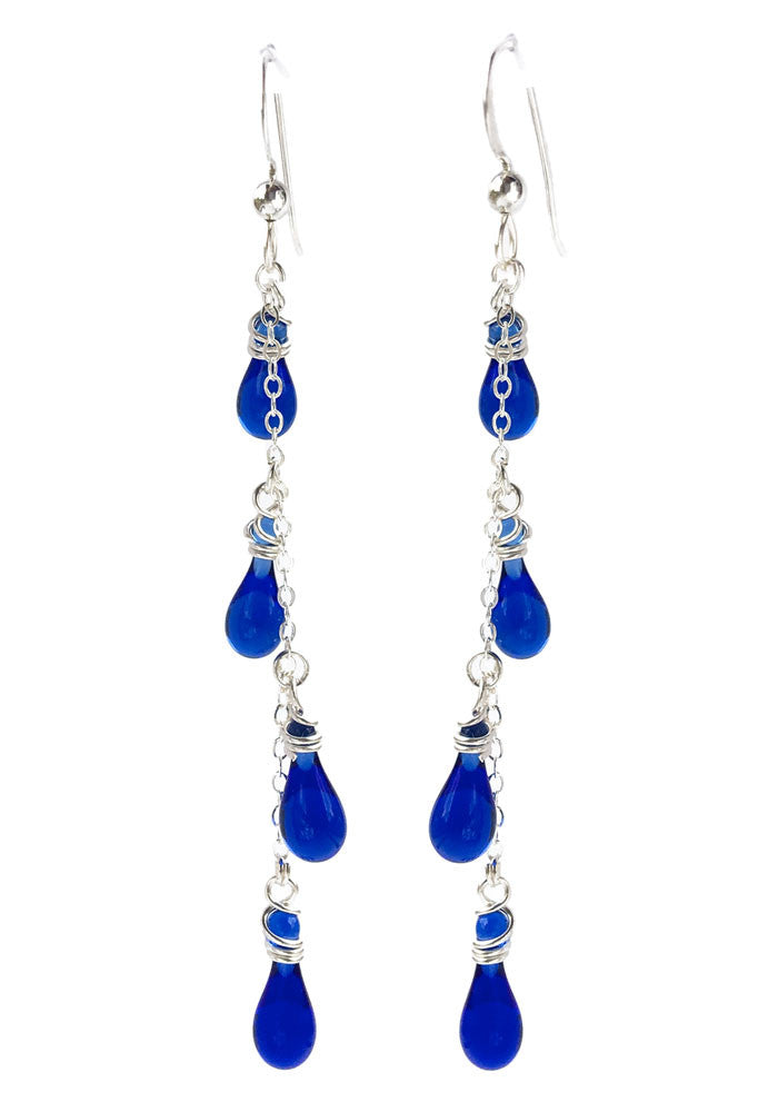 Dangling yet dainty, these fun silver and glass drop handcrafted earrings conjure visions of flowering vines.