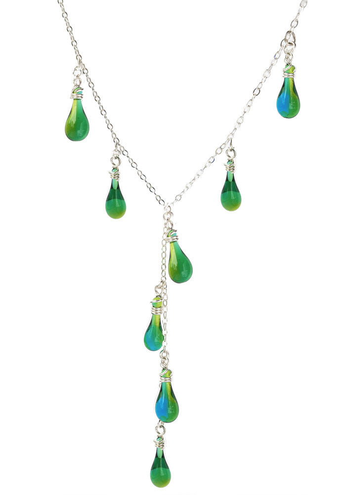 Tiny teardrops of vibrant color march up each side of the necklace in harmony with the dainty drops alternating down a dangling center chain in sterling silver.