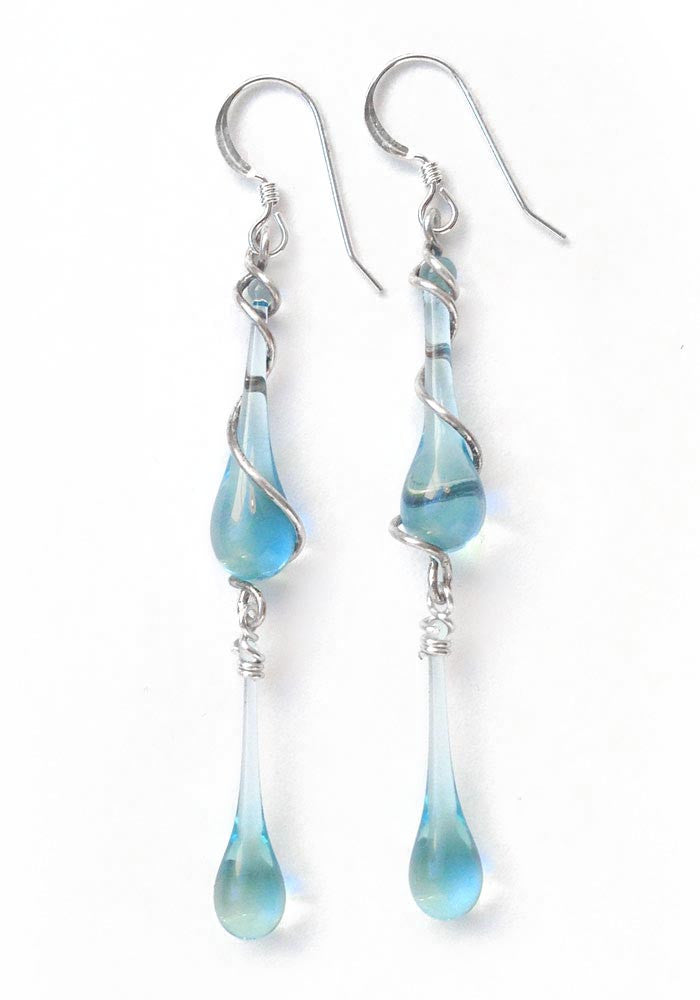 Upcycled jewelry takes on a whole new look!  Will you wear these recycled Skyy Vodka glass and spiraling silver dangle earrings to make a dramatic statement at the office, or to dress up your denim for a fun, casual weekend?