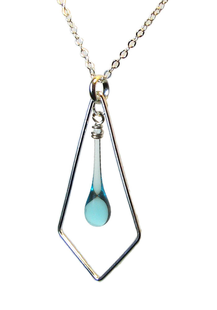 Geometric silver and light blue glass drop necklace, melted with sunlight concentrated by a giant magnifying glass.