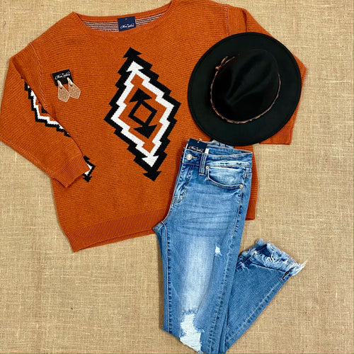 Rust Aztec print sweater