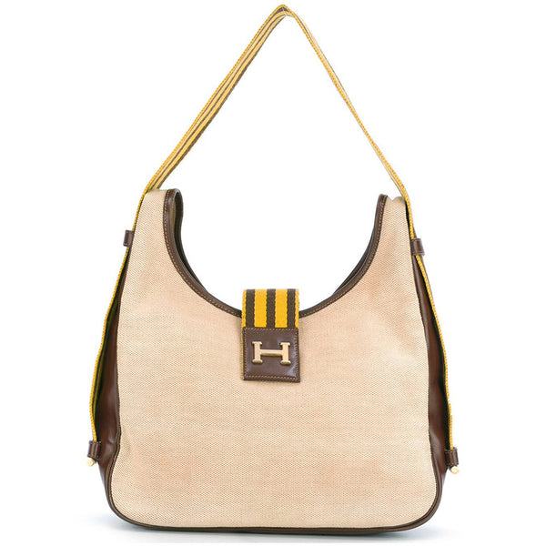 070572b83428 Fun   unusual Hermès vintage Tsako yellow striped canvas bag c.1970 -  Katheleys for