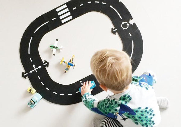 Image of a child playing with Waytoplay rubber road toy
