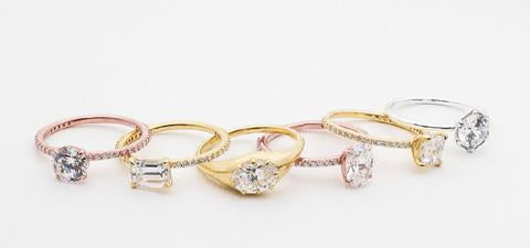 6 engagement rings in rose, white, and yellow gold with a variety of shaped diamonds and either a plain band or pave diamond band