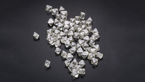 Pile of octahedron diamonds on a black background.