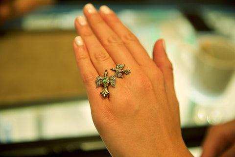 Arman double bird ring on hand