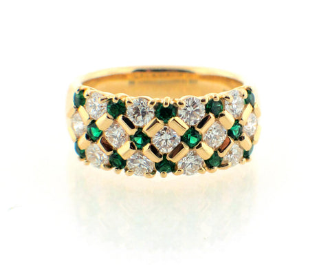 Emerald and diamond honeycomb looking yellow gold ring.