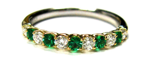 Emerald and diamond ring with 11 stones total.