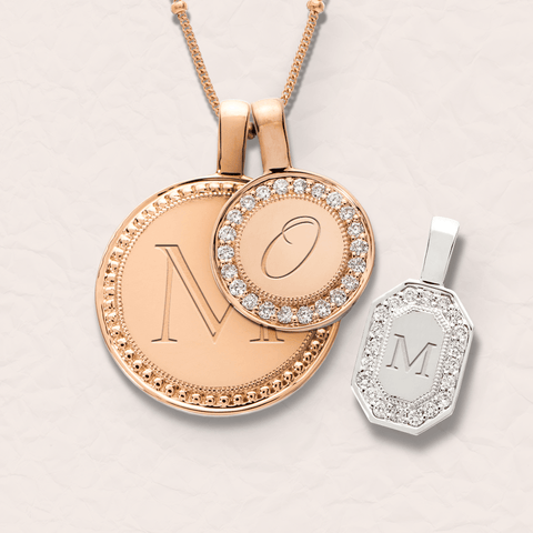 Initial pendants spelling mom