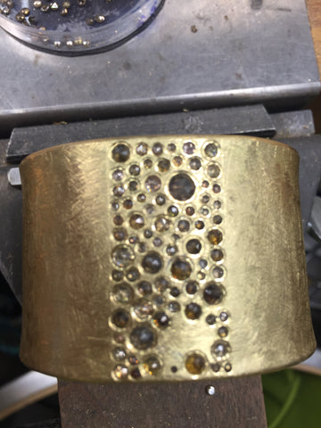 close up of unfinished 18k yellow gold todd reed bracelet