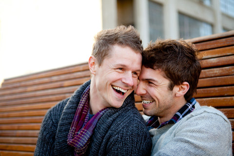 engagement photo with two men on a bench