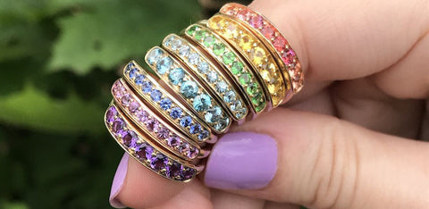 Jane Taylor 18k gold Rings creating a rainbow on a finger