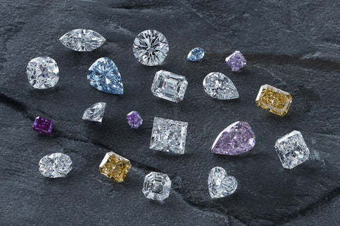 Various colors and shapes and sizes of diamonds
